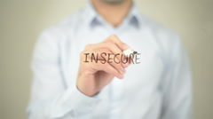 Insecure, man writing on transparent screen - stock footage