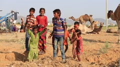 Poor children involved in Pushkar Camel Mela , India Stock Footage