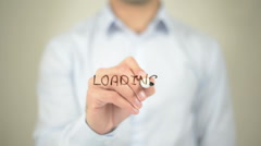Loading, man writing on transparent screen Stock Footage