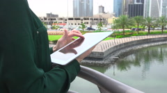 Woman scrolling the tablet on the terrace Stock Footage