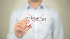 No Terrorism, man writing on transparent screen Stock Footage