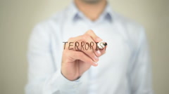 Terrorism, man writing on transparent screen - stock footage