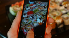 The man on the smartphone photography food seafood cooking sushi Asian cuisine. Stock Footage