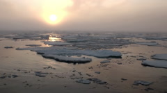 Sunset in ocean among icebergs and ice in Arctic. Stock Footage