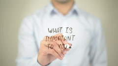 What is Important to You ? , man writing on transparent screen - stock footage