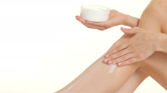 Close up of woman creams her leg - stock footage