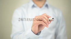 International Law, man writing on transparent screen Stock Footage