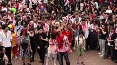 Zombie walk festival, young zombies dancing together on street Stock Footage