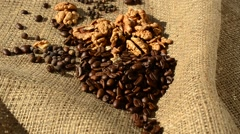 Coffee, walnut and pepper on a sacking. Stock Footage