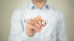 Accredited, man writing on transparent screen Stock Footage