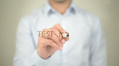 Test Now, man writing on transparent screen Stock Footage