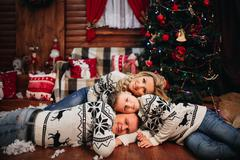 Happy Family Sitting Near Christmas Tree Stock Photos