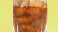 The glass with ice and bubbles Stock Footage