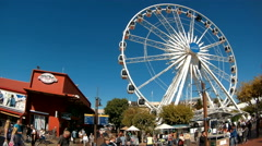 V&A Waterfront in Cape Town with ferris wheel. Stock Footage