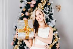Christmas, x-mas, winter, happiness concept - smiling woman with gift Stock Photos