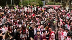 Zombie walk festival, young zombies dancing together on street - stock footage