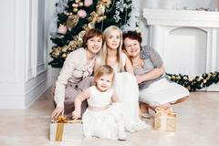 christmas, x-mas, winter, happiness concept - smiling happy family: grandmother - stock photo