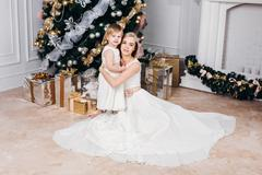 happy family mother and daughter at  New Year with gifts around the Christmas - stock photo