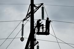 Assembly and installation of new support of a power line - stock photo