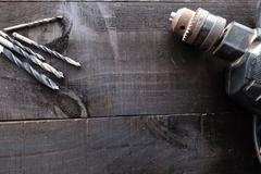 DIY construction tools on dark wood - stock photo