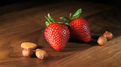 Still life macro with two strawberries and nuts Stock Footage