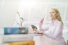 Pretty young girl is learning the subject - stock photo