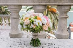 bridal bouquet of roses, freesia, eustoma - stock photo