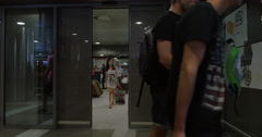 People Walking through the Sliding Doors in Airport Stock Footage