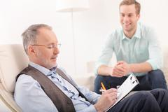 Professional psychotherapist is giving advice to patient - stock photo