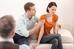 Young family is consulting a psychotherapist Stock Photos