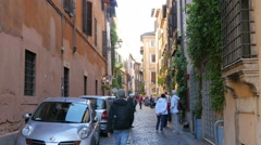 People tourists walking on cozy squares and streets of Rome Italy - stock footage
