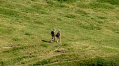 Hikers walks on the mountain road rn - stock footage