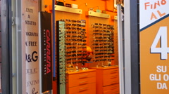 Interior of a shop of sun glasses in Rome - Italy shopping Stock Footage
