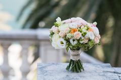 Bridal bouquet of roses, freesia, eustoma Stock Photos