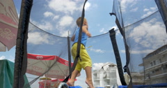 Happy Child Jumping on Trampoline Stock Footage
