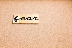 Words on sand Fear - stock photo
