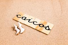 Words on sand Caicos - stock photo