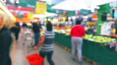 People are shopping in a supermarket, blurred background - stock footage