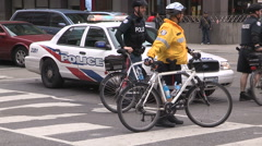 Toronto police officers block off street with police cruiser and bikes Stock Footage