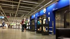 People taking elevator inside Ikea store Stock Footage