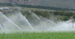 Farm agriculture water irrigation sprinklers springtime DCI 4K Stock Footage