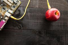 Green apple connected to a data network - stock photo
