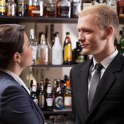 Employees in a pub after work, vertical - stock photo