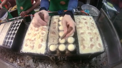 Chef preparing Japanese tako yaki squid balls. Stock Footage