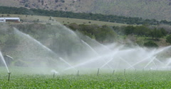 Irrigation springtime agriculture farm field mountain valley DCI 4K Stock Footage