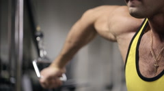Man with a strong chin in the gym trains his biceps and triceps with force Stock Footage
