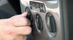Hand adjust the car climate control buttons Stock Footage