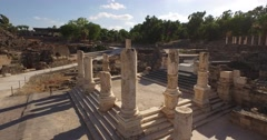 BEIT SHE'AN, ISRAEL (4K) - stunning aerial shot through ancient Roman pillars Stock Footage
