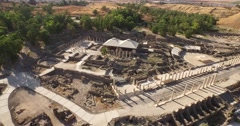 BEIT SHE'AN, ISRAEL (4K) - aerial view of destroyed Roman bathroom in city ruins Stock Footage