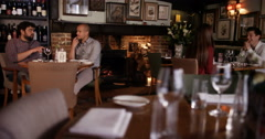4K Group of people chatting in the restaurant area of traditional British pub Stock Footage